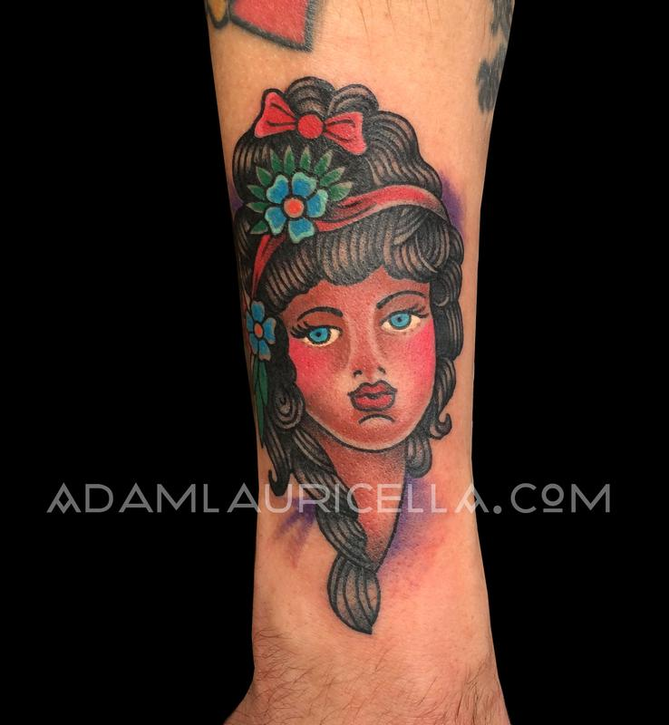 Sailor jerry girl head tattoo by adam lauricella tattoonow for Girl head tattoo