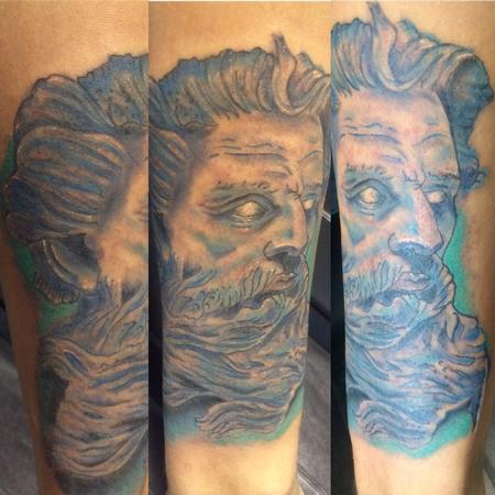 Blue water Jesus or maybe Neptune. Possibly Posiden. Definitely not Zeus