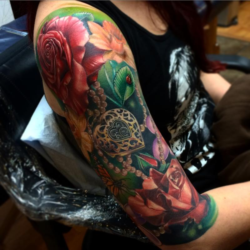Realistic Flower Tattoos On The Right Forearm Tattoo: Realistic Roses With Locket And Lady Bug Color Tattoo