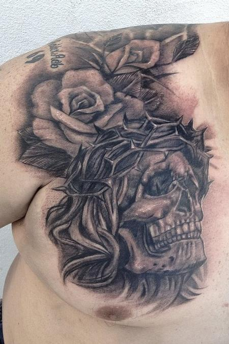 Big Gus - black and gray skull with roses tattoo