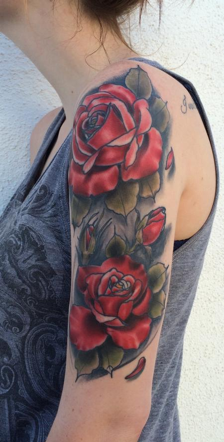 Mike Riedl - Traditional color rose half sleeve tattoo. Mike Riedl Art Junkies Tattoo