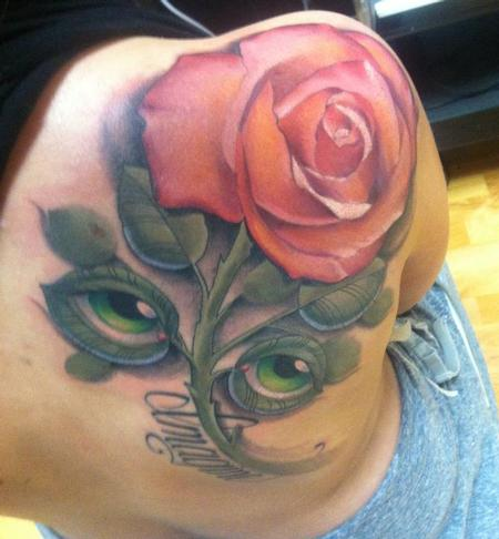 Tim Mcevoy - colored realistic rose with eyes as leaves tattoo