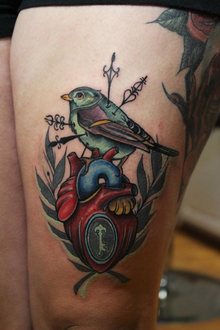 Traditional color bird with heart tattoo. Mike Riedl Art Junkies Tattoo Tattoo Design Thumbnail