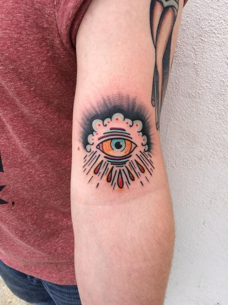 Mike Riedl - Traditional color eye crying in clouds tattoo, Mike Riedl Art Junkies Tattoo