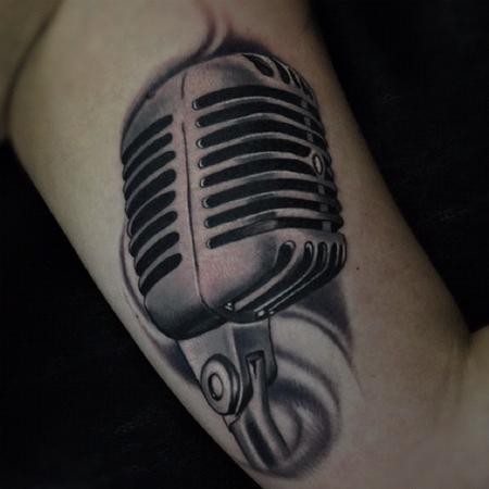 Aric Taylor The Dark Horse - black and gray microphone tattoo