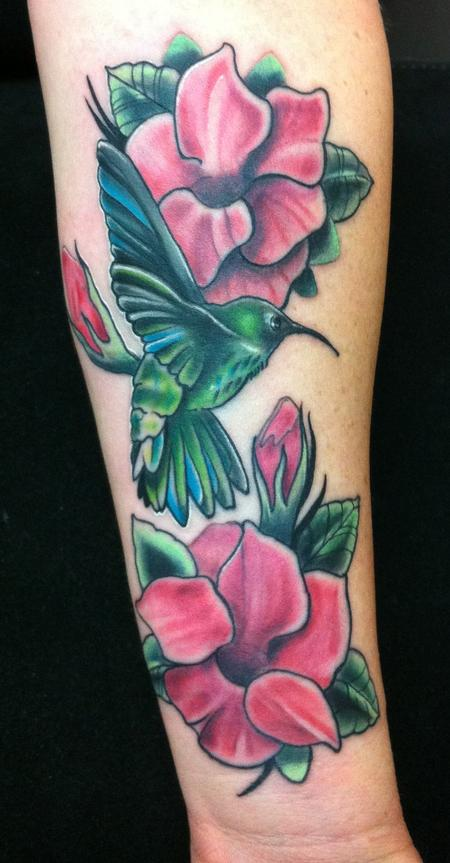 Mike Riedl - colored humming bird with crimson mandevilla flowers tattoo.