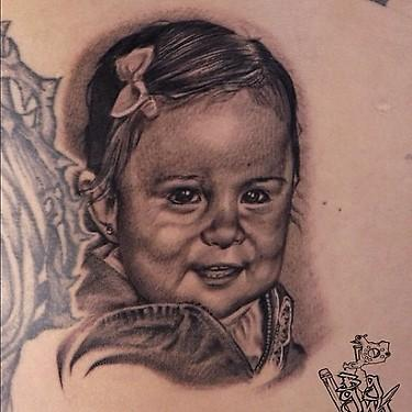 Big Gus - black and grey realistic portrait tattoo