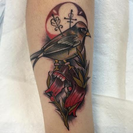 Mike Riedl - Traditional color bird with bottom jaw of skull tattoo. Mike Riedl Art Junkies Tattoo