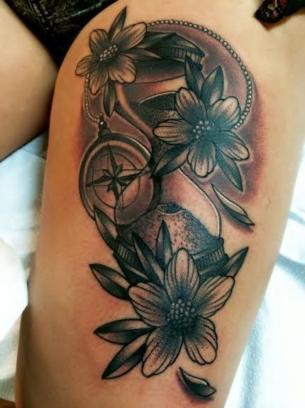 Frichard Adams - Black and Gray traditional compass with flowers tattoo. Frichard Adams Art Junkies Tattoo