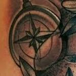 Black and Gray traditional compass with flowers tattoo. Frichard Adams Art Junkies Tattoo  Tattoo Design Thumbnail