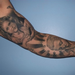 Ray's black and grey religious sleeve Tattoo Thumbnail