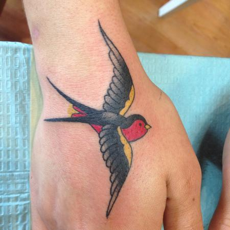 Traditional barn swallow tattoo by kyle grover tattoonow for Swallow hand tattoo