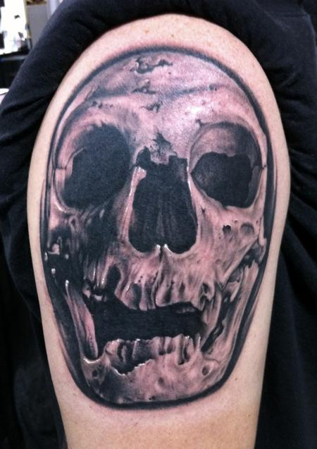 Bob Tyrrell - Neanderthal skull tattoo