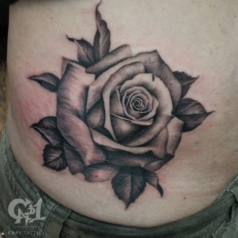 Black and grey rib cage rose tattoo by capone tattoonow for Tattoo shops denton tx
