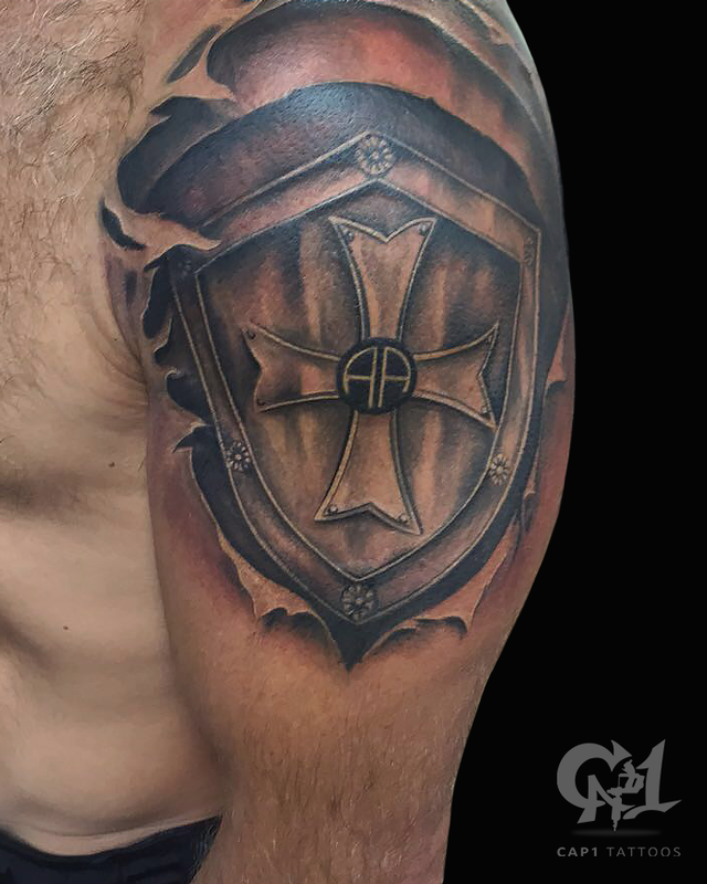 Skin rip shield tattoo by capone tattoonow for Skin gallery tattoo
