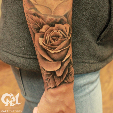 Realistic rosebud and free flowing leaves Tattoo Design Thumbnail