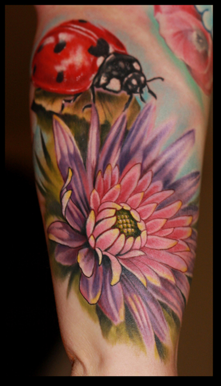 Ladybug and flower by Cory Norris: TattooNOW