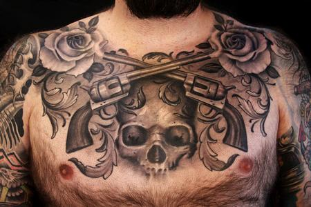 black and grey chest piece Tattoo Design