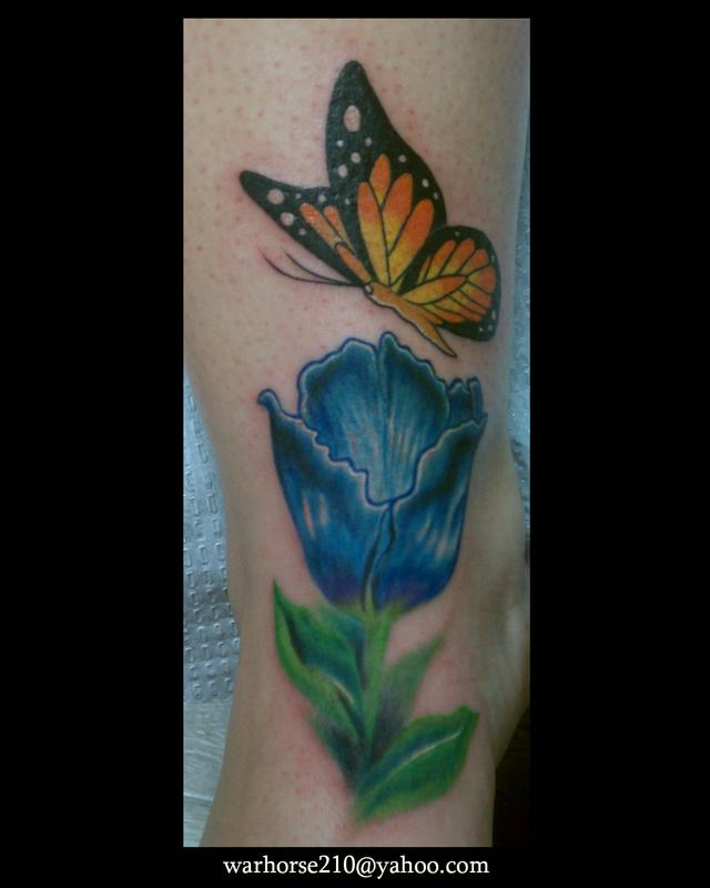 Flower and butterfly by javier tattoonow for Element tattoo san antonio