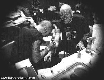 Tattoos - Sean tattooing the Enigma - 6670