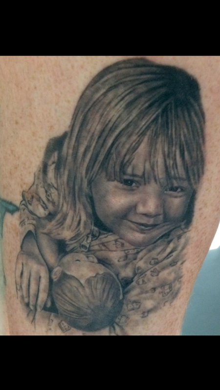 Child Holding Doll Portrait Tattoo Design
