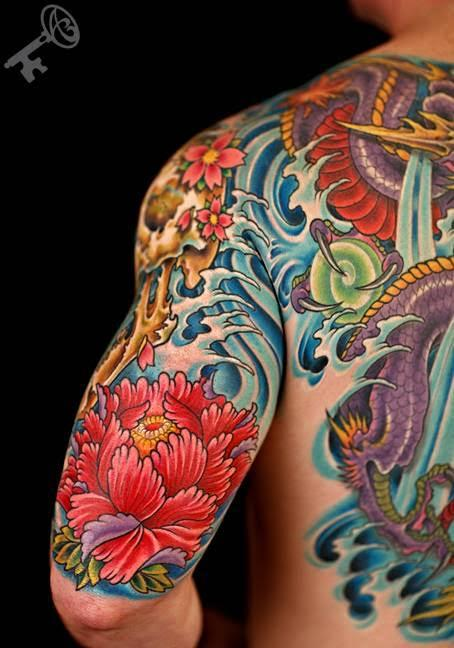 Colored flower tattoo by durb tattoos for Japanese wave and flower tattoo