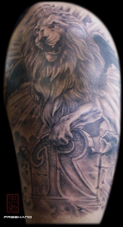 Winged lion tattoo - photo#4