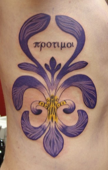 "5"" iris tattoo on the back of"