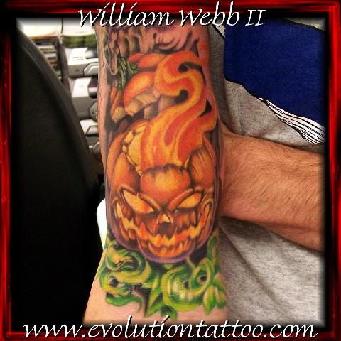 Flaming pumpkin by billy webb ii tattoonow for Evolution tattoo studio
