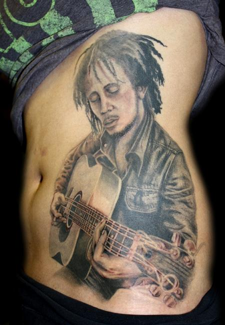 Angela Leaf - black and grey bob marley portrait tattoo