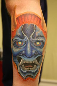 Asian mask tattoo by dominic norman tattoonow for Tattoo shops in norman