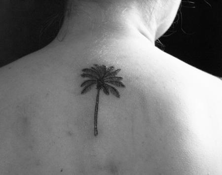 Small palm tree tattoo on back Tattoo Design Thumbnail