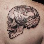 Skull with rainbow trout tattoo on shoulder Tattoo Design Thumbnail