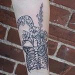 Black illustrative rib cage with wild flowers tattoo on forearm Tattoo Design Thumbnail