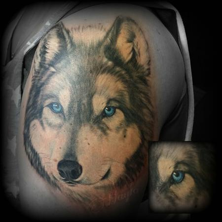 Realistic wolf with blue eyes Tattoo Design Thumbnail