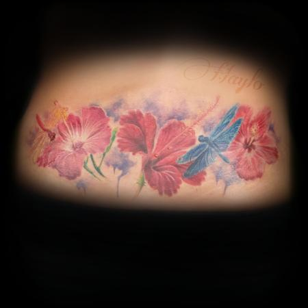 Haylo - Lower back custom, realistic style tattoo with hibiscus flowers, and dragonflies with watercolor accents