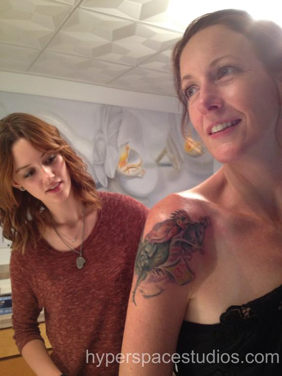 Michele Wortman - Mother and daughter checking out tattoo