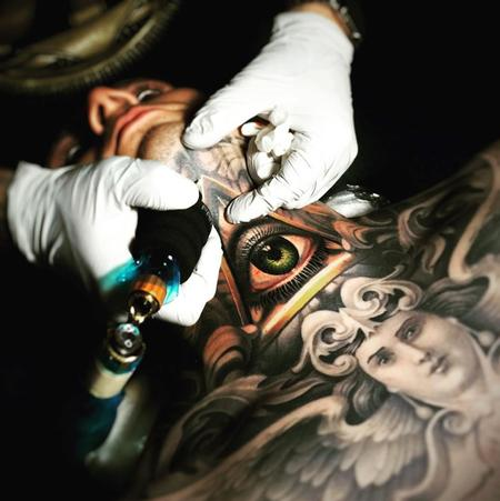 Nikko Hurtado - Eye throat tattoo