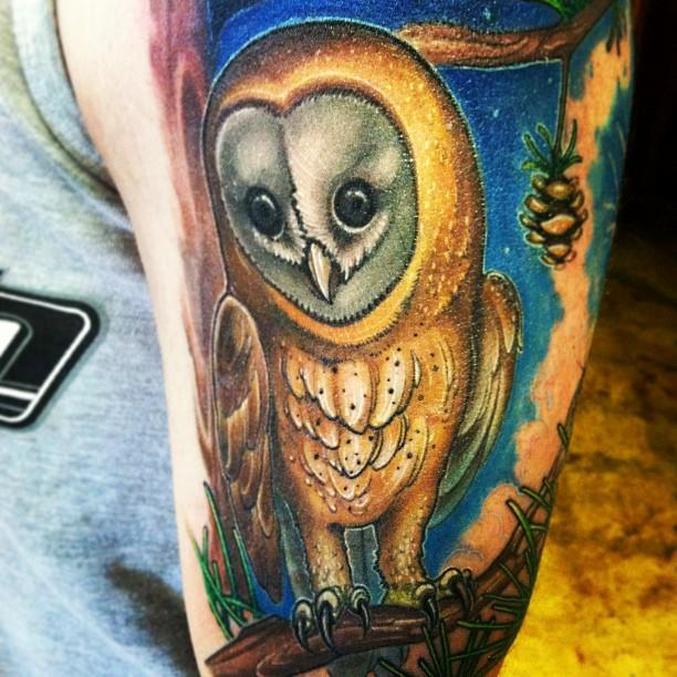 Realistic barn owl tattoo
