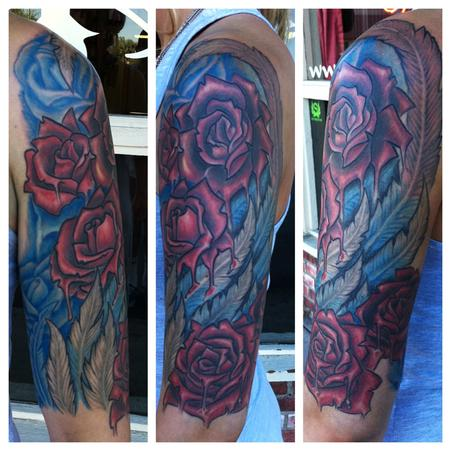 Jeff Johnson Rose and Wing Tattoo