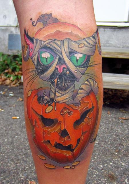 halloween black cat in pumpkin color leg tattoo Tattoo Design Thumbnail
