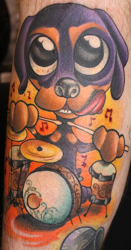 Rottie Puppy playing drums Tattoo Design Thumbnail