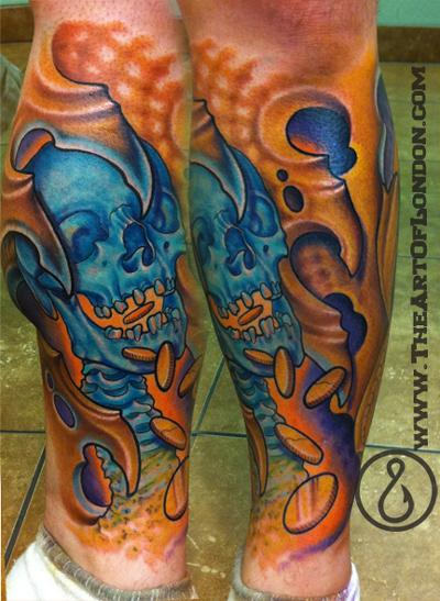 This skull biomech tattoo represents the greed associated with money and is