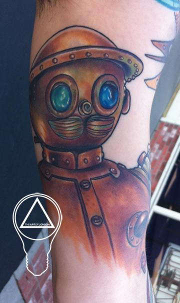 Brittan London Reese - Tick Tock Return to Oz Tattoo