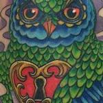 Owl holding heart and key Tattoo Design Thumbnail