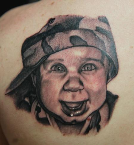 Mario Rosenau - black and gray portrait tattoo