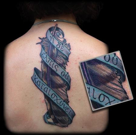 Maximilian Rothert - color owl feather and greek banner tattoo