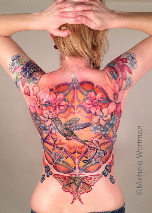 Michele Wortman - Pirkkos Hummingbird in cosmic garden back piece