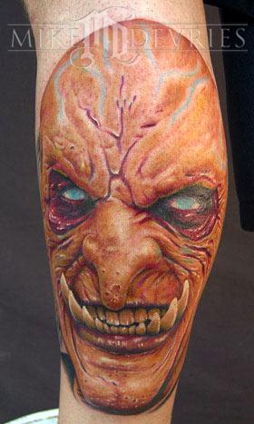 Mike devries tattoos evil evil face tattoo for Evil faces tattoos