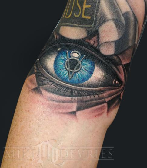 Mike DeVries - Vintage logo eye flag tattoo